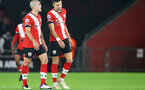 SOUTHAMPTON, ENGLAND - DECEMBER 19: Oriol Romeu (L) and Jan Bednarek (R) of Southampton during the Premier League match between Southampton and Manchester City at St Mary's Stadium on December 19, 2020 in Southampton, England. A limited number of fans (2000) are welcomed back to stadiums to watch elite football across England. This was following easing of restrictions on spectators in tiers one and two areas only. (Photo by Matt Watson/Southampton FC via Getty Images)