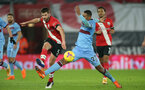 SOUTHAMPTON, ENGLAND - DECEMBER 29: Jack Stephens(L)  of Southampton and Sebastien Haller (R) of West Ham during the Premier League match between Southampton and West Ham United at St Mary's Stadium on December 29, 2020 in Southampton, England. The match will be played without fans, behind closed doors as a Covid-19 precaution. (Photo by Matt Watson/Southampton FC via Getty Images)