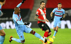 SOUTHAMPTON, ENGLAND - DECEMBER 29: Angelo Ogbonna(L) of West Ham and Danny Ings (R) of Southampton during the Premier League match between Southampton and West Ham United at St Mary's Stadium on December 29, 2020 in Southampton, England. The match will be played without fans, behind closed doors as a Covid-19 precaution. (Photo by Matt Watson/Southampton FC via Getty Images)