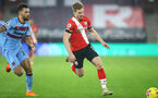 SOUTHAMPTON, ENGLAND - DECEMBER 29: Stuart Armstrong(R) of Southampton during the Premier League match between Southampton and West Ham United at St Mary's Stadium on December 29, 2020 in Southampton, England. (Photo by Matt Watson/Southampton FC via Getty Images)