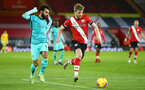 SOUTHAMPTON, ENGLAND - JANUARY 04: Mohaed Salah(L) of Liverpool and Stuart Armstrong (R) of Southampton during the Premier League match between Southampton and Liverpool at St Mary's Stadium on January 04, 2021 in Southampton, England. (Photo by Matt Watson/Southampton FC via Getty Images)
