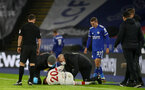 LEICESTER, ENGLAND - JANUARY 16: Will Smallbone of Southampton receives treatment during the Premier League match between Leicester City and Southampton at The King Power Stadium on January 16, 2021 in Leicester, England. Sporting stadiums around England remain under strict restrictions due to the Coronavirus Pandemic as Government social distancing laws prohibit fans inside venues resulting in games being played behind closed doors. (Photo by Matt Watson/Southampton FC via Getty Images)