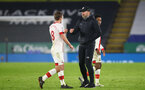 LEICESTER, ENGLAND - JANUARY 16: James Ward-Prowse (L) of Southampton and Ralph Hasenhuttl (R) Southampton manager after the Premier League match between Leicester City and Southampton at The King Power Stadium on January 16, 2021 in Leicester, England. Sporting stadiums around England remain under strict restrictions due to the Coronavirus Pandemic as Government social distancing laws prohibit fans inside venues resulting in games being played behind closed doors. (Photo by Matt Watson/Southampton FC via Getty Images)