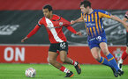 SOUTHAMPTON, ENGLAND - JANUARY 19: Caleb Watts(L) of Southampton and Matthew Pennington (R) Shrewsbury during the FA Cup Third Round match between Southampton and Shrewsbury Town on January 19, 2021 in Southampton, England. Sporting stadiums around the UK remain under strict restrictions due to the Coronavirus Pandemic as Government social distancing laws prohibit fans inside venues resulting in games being played behind closed doors. (Photo by Matt Watson/Southampton FC via Getty Images)
