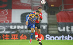 SOUTHAMPTON, ENGLAND - JANUARY 19: Scott Golbourne (L) of Shrewsbury and Yan Valery (R) of Southampton during the FA Cup Third Round match between Southampton and Shrewsbury Town on January 19, 2021 in Southampton, England. Sporting stadiums around the UK remain under strict restrictions due to the Coronavirus Pandemic as Government social distancing laws prohibit fans inside venues resulting in games being played behind closed doors. (Photo by Matt Watson/Southampton FC via Getty Images)