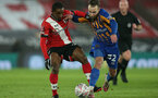 SOUTHAMPTON, ENGLAND - JANUARY 19: Ibrahima Diallo (L) of Southampton and Harry Chapman (R) of Shrewsbury during the FA Cup Third Round match between Southampton and Shrewsbury Town on January 19, 2021 in Southampton, England. Sporting stadiums around the UK remain under strict restrictions due to the Coronavirus Pandemic as Government social distancing laws prohibit fans inside venues resulting in games being played behind closed doors. (Photo by Matt Watson/Southampton FC via Getty Images)
