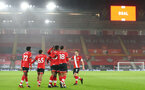 SOUTHAMPTON, ENGLAND - JANUARY 19: Dan N'Lundulu of Southampton celebrates goal with team mates during the FA Cup Third Round match between Southampton and Shrewsbury Town on January 19, 2021 in Southampton, England. Sporting stadiums around the UK remain under strict restrictions due to the Coronavirus Pandemic as Government social distancing laws prohibit fans inside venues resulting in games being played behind closed doors. (Photo by Matt Watson/Southampton FC via Getty Images)