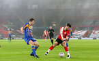 SOUTHAMPTON, ENGLAND - JANUARY 19: Shane Long (R) of Southampton during the FA Cup Third Round match between Southampton and Shrewsbury Town on January 19, 2021 in Southampton, England. Sporting stadiums around the UK remain under strict restrictions due to the Coronavirus Pandemic as Government social distancing laws prohibit fans inside venues resulting in games being played behind closed doors. (Photo by Matt Watson/Southampton FC via Getty Images)