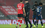 SOUTHAMPTON, ENGLAND - JANUARY 26: Jan Bednarek (L) of Southampton and Ralph Hasenhuttl (R) during the Premier League match between Southampton and Arsenal at St Mary's Stadium on January 26, 2021 in Southampton, England. Sporting stadiums around the UK remain under strict restrictions due to the Coronavirus Pandemic as Government social distancing laws prohibit fans inside venues resulting in games being played behind closed doors. (Photo by Chris Moorhouse/Southampton FC via Getty Images)
