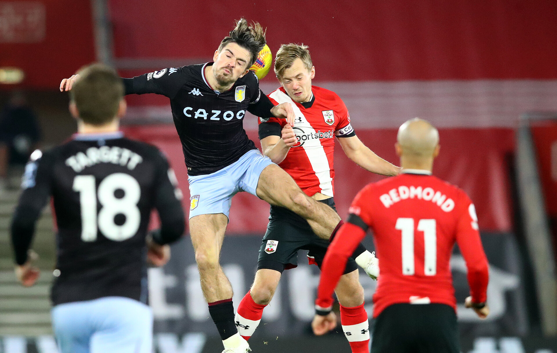 SOUTHAMPTON, ENGLAND - JANUARY 30: Jack Grealish(L) of Aston Villa and James Ward-Prowse(R) of Southampton during the Premier League match between Southampton and Aston Villa at St Mary's Stadium on January 30, 2021 in Southampton, England. Sporting stadiums around the UK remain under strict restrictions due to the Coronavirus Pandemic as Government social distancing laws prohibit fans inside venues resulting in games being played behind closed doors. (Photo by Matt Watson/Southampton FC via Getty Images)