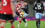 SOUTHAMPTON, ENGLAND - JANUARY 30: Stuart Armstrong (L) of Southampton and Matthew Cash (R) of Aston Villa during the Premier League match between Southampton and Aston Villa at St Mary's Stadium on January 30, 2021 in Southampton, England. Sporting stadiums around the UK remain under strict restrictions due to the Coronavirus Pandemic as Government social distancing laws prohibit fans inside venues resulting in games being played behind closed doors. (Photo by Matt Watson/Southampton FC via Getty Images)