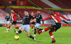 SOUTHAMPTON, ENGLAND - JANUARY 30: John McGinn (L) of Aston Villa and Ibrahima Diallo (R) of Southampton during the Premier League match between Southampton and Aston Villa at St Mary's Stadium on January 30, 2021 in Southampton, England. Sporting stadiums around the UK remain under strict restrictions due to the Coronavirus Pandemic as Government social distancing laws prohibit fans inside venues resulting in games being played behind closed doors. (Photo by Matt Watson/Southampton FC via Getty Images)