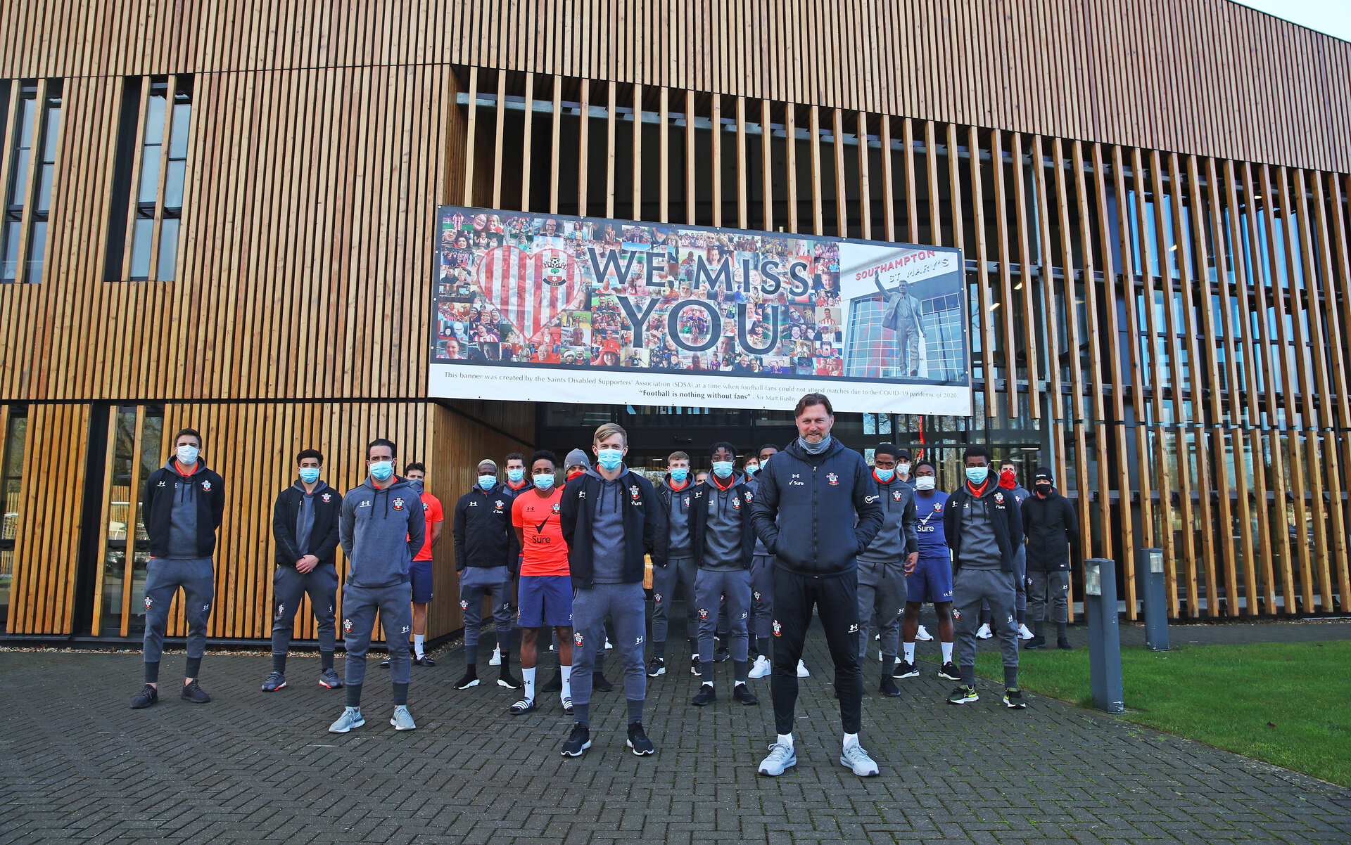 Players and staff gather in front of the Markus Liebherr Pavillion, at The Staplewood Campus, Southampton, as a fans banner is put in place to show support to players and staff, 5th February 2021, pic by Matt Watson/Southampton FC