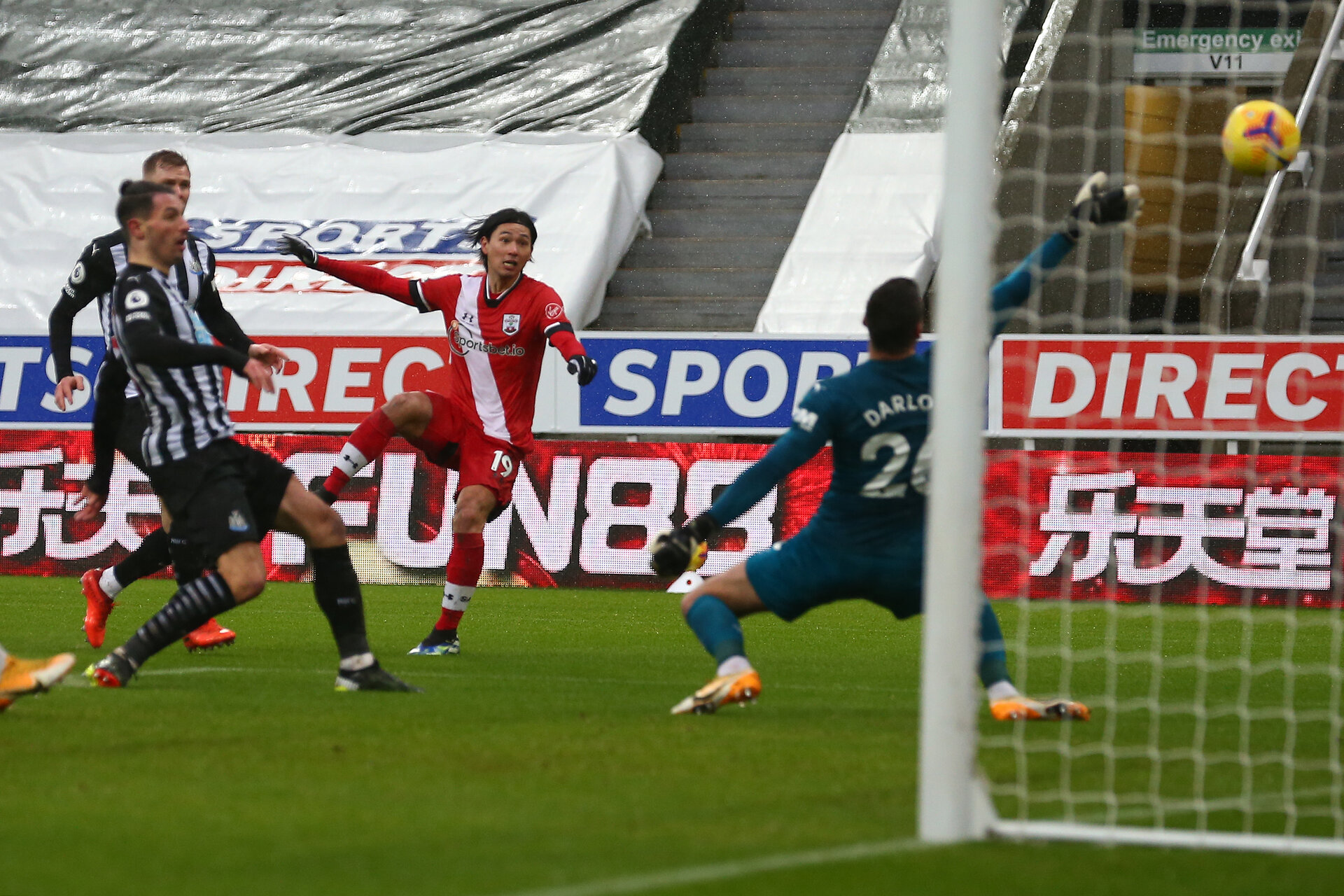 NEWCASTLE UPON TYNE, ENGLAND - FEBRUARY 06: Takumi Minamino of Southampton opens the scoring for Southampton during the Premier League match between Newcastle United and Southampton at St. James Park on February 06, 2021 in Newcastle upon Tyne, England. Sporting stadiums around the UK remain under strict restrictions due to the Coronavirus Pandemic as Government social distancing laws prohibit fans inside venues resulting in games being played behind closed doors. (Photo by Matt Watson/Southampton FC via Getty Images)