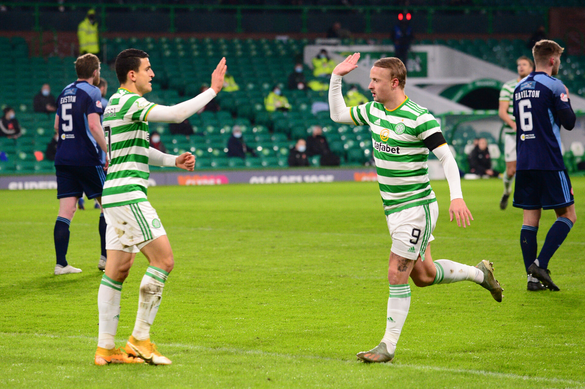 GLASGOW, SCOTLAND - JANUARY 27: Leigh Griffiths of Celtic celebrates after scoring their sides first goal with Mohamed Elyounoussi during the Ladbrokes Scottish Premiership match between Celtic and Hamilton Academical at Celtic Park on January 27, 2021 in Glasgow, Scotland. Sporting stadiums around the UK remain under strict restrictions due to the Coronavirus Pandemic as Government social distancing laws prohibit fans inside venues resulting in games being played behind closed doors. (Photo by Mark Runnacles/Getty Images)
