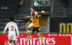 WOLVERHAMPTON, ENGLAND - FEBRUARY 11: Jan Bednarek(L) of Southampton and Vitinha (R) of Wolves during The Emirates FA Cup Fifth Round match between Wolverhampton Wanderers and Southampton at Molineux on February 11, 2021 in Wolverhampton, England. Sporting stadiums around the UK remain under strict restrictions due to the Coronavirus Pandemic as Government social distancing laws prohibit fans inside venues resulting in games being played behind closed doors. (Photo by Matt Watson/Southampton FC via Getty Images)