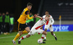 WOLVERHAMPTON, ENGLAND - FEBRUARY 11: Maximilian Kilman (L) of Wolves and James Ward-Prowse (R) of Southampton during The Emirates FA Cup Fifth Round match between Wolverhampton Wanderers and Southampton at Molineux on February 11, 2021 in Wolverhampton, England. Sporting stadiums around the UK remain under strict restrictions due to the Coronavirus Pandemic as Government social distancing laws prohibit fans inside venues resulting in games being played behind closed doors. (Photo by Matt Watson/Southampton FC via Getty Images)