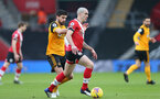 SOUTHAMPTON, ENGLAND - FEBRUARY 14: Ruben Neves (L) of Wolves and Oriol Romeu (R) of Southampton during the Premier League match between Southampton and Wolverhampton Wanderers at St Mary's Stadium on February 14, 2021 in Southampton, England. Sporting stadiums around the UK remain under strict restrictions due to the Coronavirus Pandemic as Government social distancing laws prohibit fans inside venues resulting in games being played behind closed doors. (Photo by Matt Watson/Southampton FC via Getty Images)