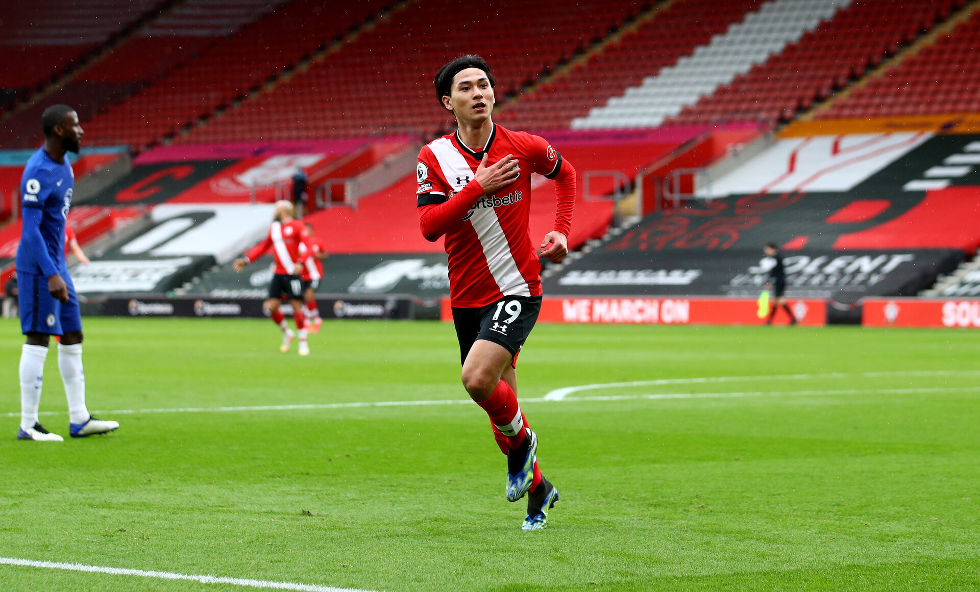 SOUTHAMPTON, ENGLAND - FEBRUARY 20: Takumi Minamino of celebrates after scoring the opening goal during the Premier League match between Southampton and Chelsea at St Mary's Stadium on February 20, 2021 in Southampton, England. Sporting stadiums around the UK remain under strict restrictions due to the Coronavirus Pandemic as Government social distancing laws prohibit fans inside venues resulting in games being played behind closed doors. (Photo by Matt Watson/Southampton FC via Getty Images)
