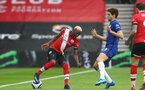 SOUTHAMPTON, ENGLAND - FEBRUARY 20: Moussa Djenepo (L) of Southampton and Marcos Alonso (R) of Chelsea during the Premier League match between Southampton and Chelsea at St Mary's Stadium on February 20, 2021 in Southampton, England. Sporting stadiums around the UK remain under strict restrictions due to the Coronavirus Pandemic as Government social distancing laws prohibit fans inside venues resulting in games being played behind closed doors. (Photo by Matt Watson/Southampton FC via Getty Images)