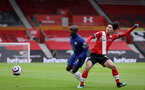 SOUTHAMPTON, ENGLAND - FEBRUARY 20: N'Golo Kante (L) of Chelsea and of Southampton Takumi Minamino (L) of Southampton during the Premier League match between Southampton and Chelsea at St Mary's Stadium on February 20, 2021 in Southampton, England. Sporting stadiums around the UK remain under strict restrictions due to the Coronavirus Pandemic as Government social distancing laws prohibit fans inside venues resulting in games being played behind closed doors. (Photo by Matt Watson/Southampton FC via Getty Images)