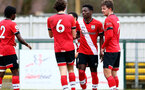 SOUTHAMPTON, ENGLAND - FEBRUARY 21: Kazeem Olaigbe of Southampton team mates celebrates with him after scoring during Premier League 2 match between Southampton B Team and Derby County U23s at The Snows Stadium on February 21, 2021 in Southampton, England. (Photo by Isabelle Field/Southampton FC via Getty Images)