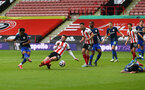 SHEFFIELD, ENGLAND - MARCH 06: Nathan Tella(L) of Southampton shoots at goal during the Premier League match between Sheffield United and Southampton at Bramall Lane on March 06, 2021 in Sheffield, England. Sporting stadiums around the UK remain under strict restrictions due to the Coronavirus Pandemic as Government social distancing laws prohibit fans inside venues resulting in games being played behind closed doors (Photo by Matt Watson/Southampton FC via Getty Images)