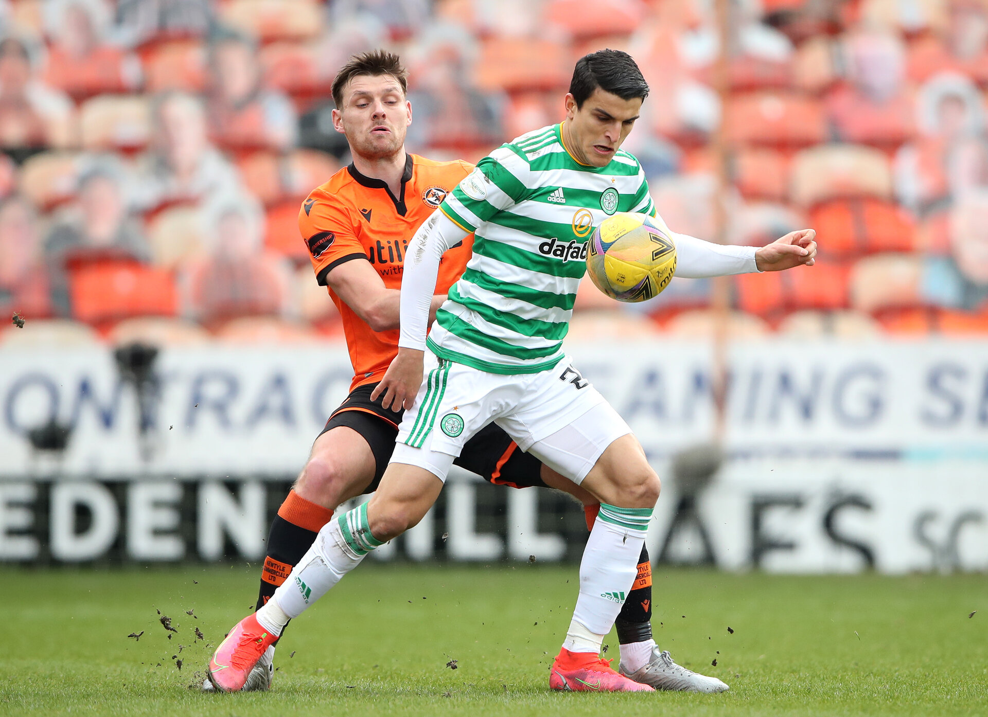 DUNDEE, SCOTLAND - MARCH 07: Ryan Edwards of Dundee United battles for possession with Mohamed Elyounoussi of Celtic during the Ladbrokes Scottish Premiership match between Dundee and Celtic at Tannadice Park on March 07, 2021 in Dundee, Scotland. Sporting stadiums around the UK remain under strict restrictions due to the Coronavirus Pandemic as Government social distancing laws prohibit fans inside venues resulting in games being played behind closed doors.  (Photo by Ian MacNicol/Getty Images)