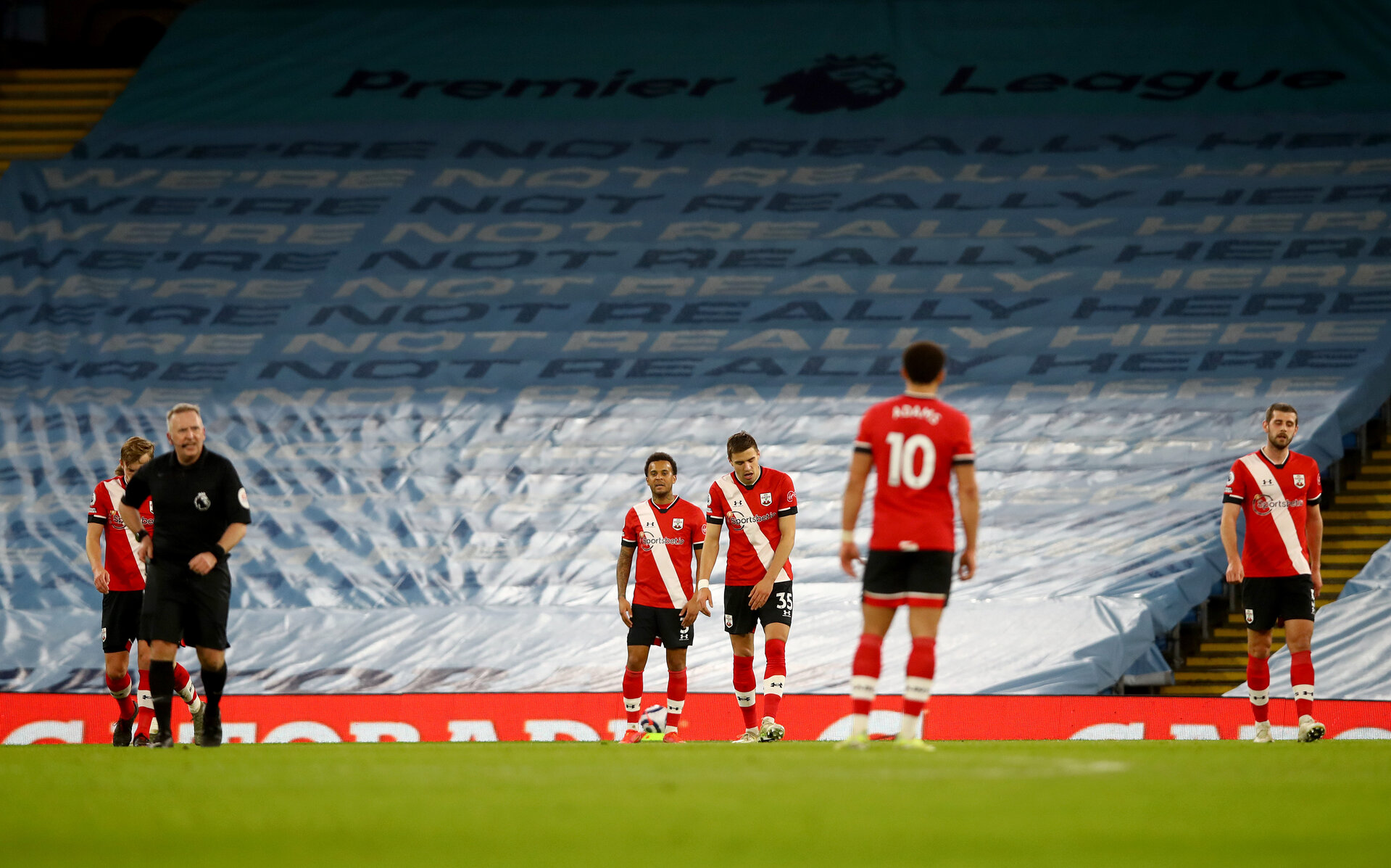 MANCHESTER, ENGLAND - MARCH 10: Southampton players dejected during the Premier League match between Manchester City and Southampton at Etihad Stadium on March 10, 2021 in Manchester, England. Sporting stadiums around the UK remain under strict restrictions due to the Coronavirus Pandemic as Government social distancing laws prohibit fans inside venues resulting in games being played behind closed doors. (Photo by Matt Watson/Southampton FC via Getty Images)