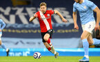 MANCHESTER, ENGLAND - MARCH 10: Stuart Armstrong of Southampton during the Premier League match between Manchester City and Southampton at Etihad Stadium on March 10, 2021 in Manchester, England. Sporting stadiums around the UK remain under strict restrictions due to the Coronavirus Pandemic as Government social distancing laws prohibit fans inside venues resulting in games being played behind closed doors. (Photo by Matt Watson/Southampton FC via Getty Images)