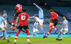 MANCHESTER, ENGLAND - MARCH 10: Jannik Vestergaard(R) of Southampton attacking header during the Premier League match between Manchester City and Southampton at Etihad Stadium on March 10, 2021 in Manchester, England. Sporting stadiums around the UK remain under strict restrictions due to the Coronavirus Pandemic as Government social distancing laws prohibit fans inside venues resulting in games being played behind closed doors. (Photo by Matt Watson/Southampton FC via Getty Images)