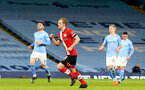 MANCHESTER, ENGLAND - MARCH 10: James Ward-Prowse  goal celebration after equalizing for Southampton during the Premier League match between Manchester City and Southampton at Etihad Stadium on March 10, 2021 in Manchester, England. Sporting stadiums around the UK remain under strict restrictions due to the Coronavirus Pandemic as Government social distancing laws prohibit fans inside venues resulting in games being played behind closed doors. (Photo by Matt Watson/Southampton FC via Getty Images)