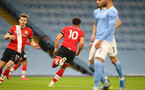 MANCHESTER, ENGLAND - MARCH 10: Ché Adams of Southampton  scores in second half during the Premier League match between Manchester City and Southampton at Etihad Stadium on March 10, 2021 in Manchester, England. Sporting stadiums around the UK remain under strict restrictions due to the Coronavirus Pandemic as Government social distancing laws prohibit fans inside venues resulting in games being played behind closed doors. (Photo by Matt Watson/Southampton FC via Getty Images)