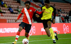 SOUTHAMPTON, ENGLAND - MARCH 23: Zuriel Otseh-Taiwo (L) of Southampton during the FA Youth Cup fourth round match between Southampton and Burton Albion at St Mary's Stadium on March 23, 2021 in Southampton, England. (Photo by Isabelle Field/Southampton FC via Getty Images)