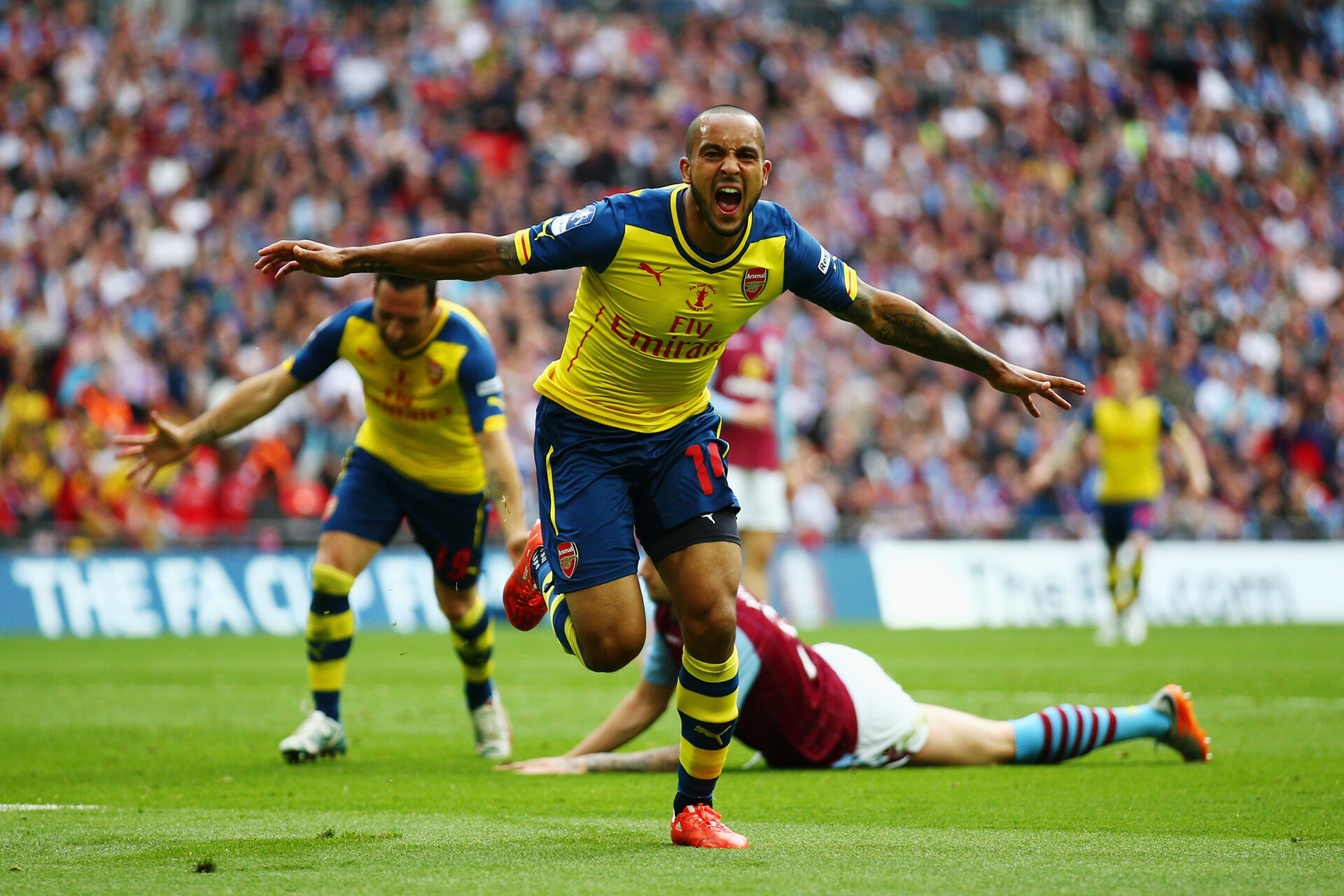 LONDON, ENGLAND - MAY 30:  Theo Walcott of Arsenal celebrates as he scores their first goal during the FA Cup Final between Aston Villa and Arsenal at Wembley Stadium on May 30, 2015 in London, England.  (Photo by Paul Gilham/Getty Images)