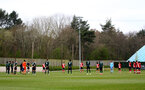SOUTHAMPTON, ENGLAND - APRIL 10: Southampton and Tottenham players take part in a minute silence ahead of kick off to pay their respects to HRH Prince Philip The Duke of Edinburgh during the Premier League U18s match between Southampton U18 and Tottenham Hotspur at Staplewood Campus on April 10, 2021 in Southampton, England. (Photo by Isabelle Field/Southampton FC via Getty Images)