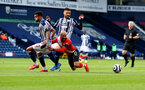 WEST BROMWICH, ENGLAND - APRIL 12: Nathan Redmond of Southampton goes down in the penalty area after being challenged by Darnell Furlong(L) of and Okay Yokuslu(R) of West Brom during the Premier League match between West Bromwich Albion and Southampton at The Hawthorns on April 12, 2021 in West Bromwich, England. Sporting stadiums around the UK remain under strict restrictions due to the Coronavirus Pandemic as Government social distancing laws prohibit fans inside venues resulting in games being played behind closed doors. (Photo by Matt Watson/Southampton FC via Getty Images)