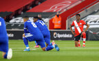 SOUTHAMPTON, ENGLAND - APRIL 30: Nathan Tella of takes a knee during the Premier League match between Southampton and Leicester City at St Mary's Stadium on April 30, 2021 in Southampton, England. Sporting stadiums around the UK remain under strict restrictions due to the Coronavirus Pandemic as Government social distancing laws prohibit fans inside venues resulting in games being played behind closed doors.  (Photo by Matt Watson/Southampton FC via Getty Images)