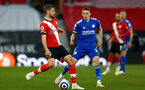 SOUTHAMPTON, ENGLAND - APRIL 30: Jack Stephens (L) of Southampton and Timothy Castagne (R) of  Leicester during the Premier League match between Southampton and Leicester City at St Mary's Stadium on April 30, 2021 in Southampton, England. Sporting stadiums around the UK remain under strict restrictions due to the Coronavirus Pandemic as Government social distancing laws prohibit fans inside venues resulting in games being played behind closed doors.  (Photo by Isabelle Field/Southampton FC via Getty Images)
