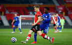 SOUTHAMPTON, ENGLAND - APRIL 30: Stuart Armstrong (L) of Southampton and Wilfred Ndidi (R) of Leicester during the Premier League match between Southampton and Leicester City at St Mary's Stadium on April 30, 2021 in Southampton, England. Sporting stadiums around the UK remain under strict restrictions due to the Coronavirus Pandemic as Government social distancing laws prohibit fans inside venues resulting in games being played behind closed doors.  (Photo by Isabelle Field/Southampton FC via Getty Images)