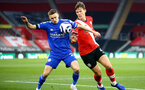 SOUTHAMPTON, ENGLAND - APRIL 30: Jannik Vestergaard (L) of Southampton and  Timothy Castagne (R) of  Leicester during the Premier League match between Southampton and Leicester City at St Mary's Stadium on April 30, 2021 in Southampton, England. Sporting stadiums around the UK remain under strict restrictions due to the Coronavirus Pandemic as Government social distancing laws prohibit fans inside venues resulting in games being played behind closed doors.  (Photo by Isabelle Field/Southampton FC via Getty Images)