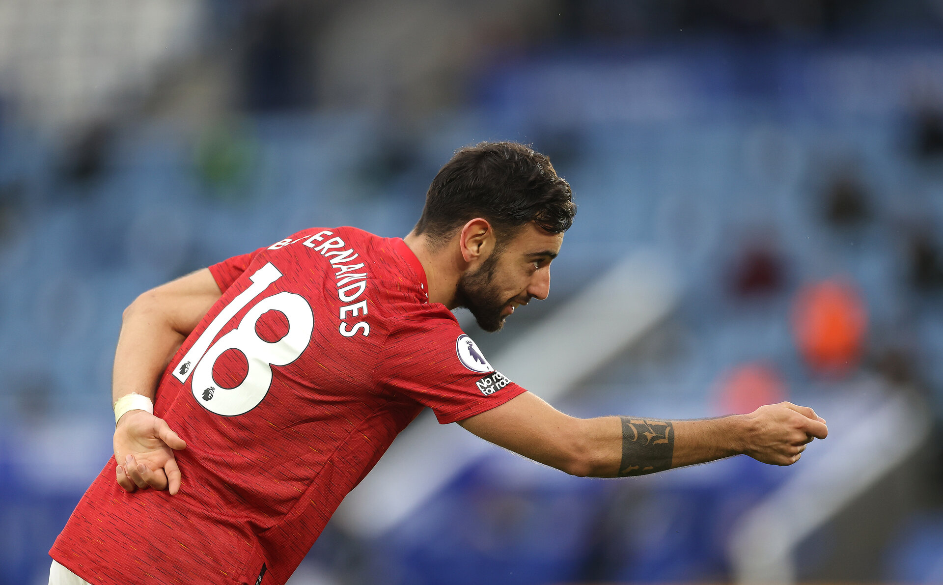LEICESTER, ENGLAND - DECEMBER 26: Bruno Fernandes of Manchester United celebrates after scoring their sides second goal during the Premier League match between Leicester City and Manchester United at The King Power Stadium on December 26, 2020 in Leicester, England. The match will be played without fans, behind closed doors as a Covid-19 precaution. (Photo by Carl Recine -Pool/Getty Images)