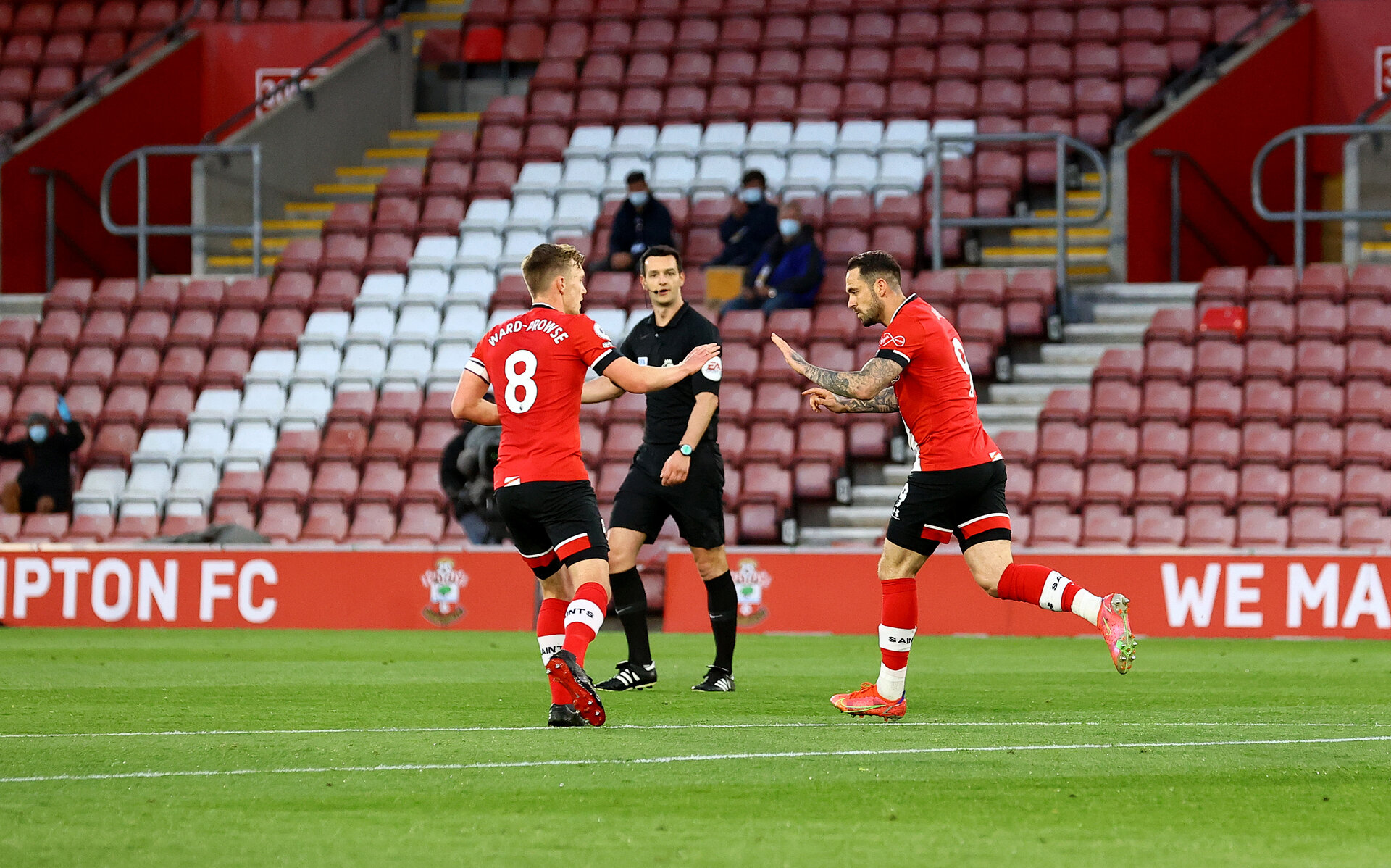 SOUTHAMPTON, ENGLAND - MAY 11: Danny Ings(R) of Southampton celebrates with James Ward-Prowse(L) after scoring during the Premier League match between Southampton and Crystal Palace at St Mary's Stadium on May 11, 2021 in Southampton, England. Sporting stadiums around the UK remain under strict restrictions due to the Coronavirus Pandemic as Government social distancing laws prohibit fans inside venues resulting in games being played behind closed doors.  (Photo by Matt Watson/Southampton FC via Getty Images)