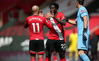 SOUTHAMPTON, ENGLAND - MAY 15: Nathan Redmond(L) of Southampton, Mohammed Salisu(center) of Southampton  and Alex McCarthy(R) of Southampton during the Premier League match between Southampton and Fulham at St Mary's Stadium on May 15, 2021 in Southampton, England. Sporting stadiums around the UK remain under strict restrictions due to the Coronavirus Pandemic as Government social distancing laws prohibit fans inside venues resulting in games being played behind closed doors.  (Photo by Matt Watson/Southampton FC via Getty Images)