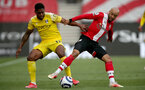 SOUTHAMPTON, ENGLAND - MAY 15: Ivan Cavaleiro(L) of Fulham and Nathan Redmond(R) of Southampton during the Premier League match between Southampton and Fulham at St Mary's Stadium on May 15, 2021 in Southampton, England. Sporting stadiums around the UK remain under strict restrictions due to the Coronavirus Pandemic as Government social distancing laws prohibit fans inside venues resulting in games being played behind closed doors.  (Photo by Matt Watson/Southampton FC via Getty Images)