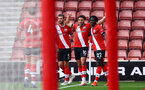 SOUTHAMPTON, ENGLAND - MAY 15: Ché Adams of Southampton celebrates opening the scoring with his team mates during the Premier League match between Southampton and Fulham at St Mary's Stadium on May 15, 2021 in Southampton, England. Sporting stadiums around the UK remain under strict restrictions due to the Coronavirus Pandemic as Government social distancing laws prohibit fans inside venues resulting in games being played behind closed doors.  (Photo by Matt Watson/Southampton FC via Getty Images)