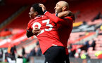 SOUTHAMPTON, ENGLAND - MAY 15: Nathan Tella(L) of Southampton celebrates scoring with Nathan Redmond(R) of Southamptonduring the Premier League match between Southampton and Fulham at St Mary's Stadium on May 15, 2021 in Southampton, England. Sporting stadiums around the UK remain under strict restrictions due to the Coronavirus Pandemic as Government social distancing laws prohibit fans inside venues resulting in games being played behind closed doors.  (Photo by Matt Watson/Southampton FC via Getty Images)