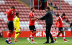 SOUTHAMPTON, ENGLAND - MAY 15: Jack Stephens(R) of Southampton and Ralph Hasenhuttl(L) during the Premier League match between Southampton and Fulham at St Mary's Stadium on May 15, 2021 in Southampton, England. Sporting stadiums around the UK remain under strict restrictions due to the Coronavirus Pandemic as Government social distancing laws prohibit fans inside venues resulting in games being played behind closed doors.  (Photo by Matt Watson/Southampton FC via Getty Images)