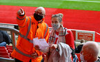 SOUTHAMPTON, ENGLAND - MAY 18: A steward directs a Southampton fan during the Premier League match between Southampton and Leeds United at St Mary's Stadium on May 18, 2021 in Southampton, England. (Photo by Isabelle Field/Southampton FC via Getty Images)