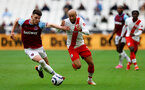 LONDON, ENGLAND - MAY 23: Nathan Redmond(R) of Southampton and Declan Rice(L) of West Ham during the Premier League match between West Ham United and Southampton at London Stadium on May 23, 2021 in London, England. (Photo by Matt Watson/Southampton FC via Getty Images)